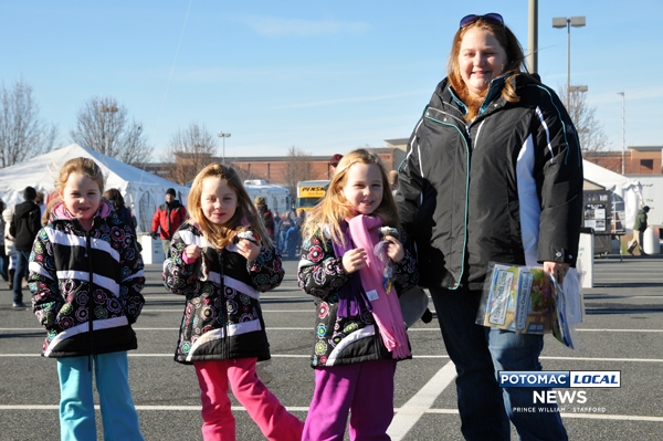 Six year old triplets, Savannah Sarah and Madison, with their Mom Melissa, took in all the fun at  Staffords 350 th Birthday Bash held in the Stafford Town Center on Saturday.