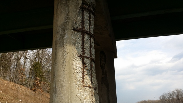 Rebar is exposed on the bridge.