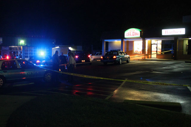 Police investigate a shooting at Delaney Plaza in Dale City