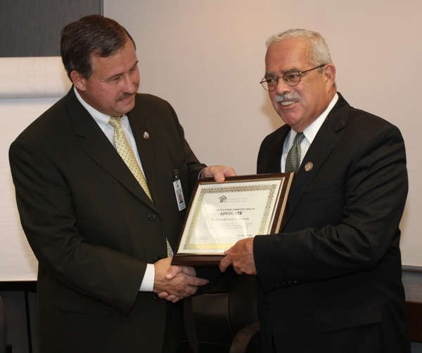 Greater Prince William Health Center Director Frank J. Principi (left) presents Rep. Gerry Connolly (right) with a national healthcare advocacy award. (Submitted)