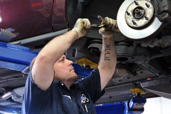 Mechanic Eran Mehler, of Lake Ridge, traded in commuting to Arlington for a less stressful commute to a job in Woodbridge. (Mary Davidson/PotomacLocal.com)