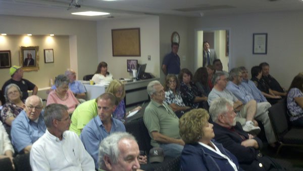 Residents filled the Dumfries Town Council Chambers on Tuesday to hear about a proposal that could bring 310-feet-tall debris hills to their town.