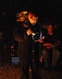 Kay Pietrewicz, of Haunted Occoquan Tours, told ghost stories of the tiny town's haunted past. (Mary Davidson/PotomacLocal.com)