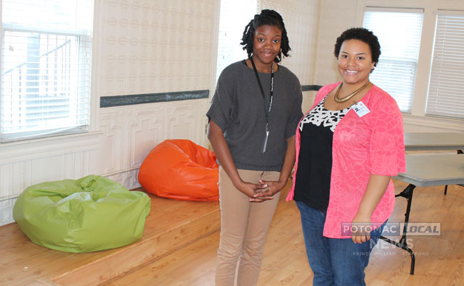 Janae Williams, 23, of Dumfries, and Brittany Jordan, 20, of Stafford, are working as part of the new Dumfries Cares program at the town's community center on Main Street. [Photo: Uriah Kiser / Potomac Local News]