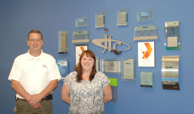 Growing the company out of a small basement to a large office, today John Jewell and Kristen Maxey work to deliver big IT services and small business solutions for JTC, Inc. in Manassas. [Kelly Harman / Potomac Local News]