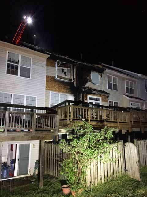 Three story townhouse burned by smoking materials on deck for 3 story townhomes